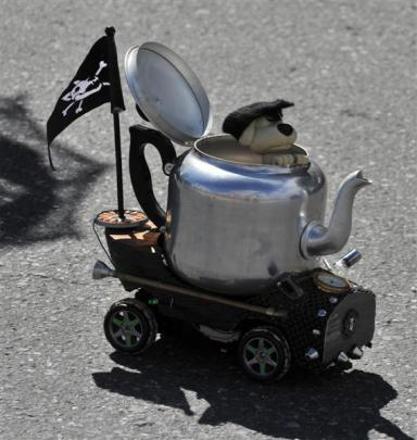 Remote-controlled racing steampunk teapots entertained the crowds watching the parade. Photo by...