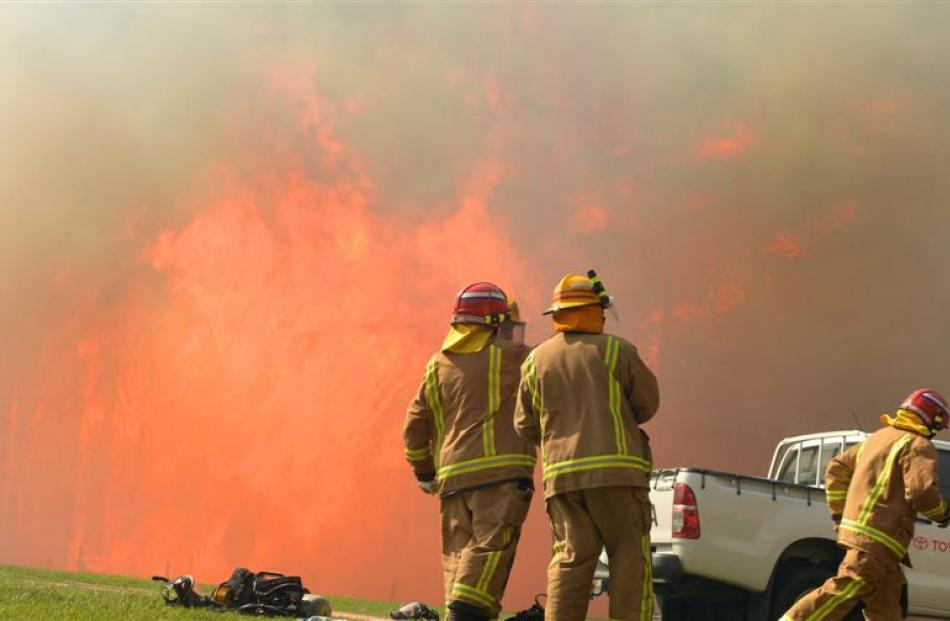 Firefighters prepare to attack the blaze in Morris Rd, Chain Hills, yesterday. Photo Stephen...