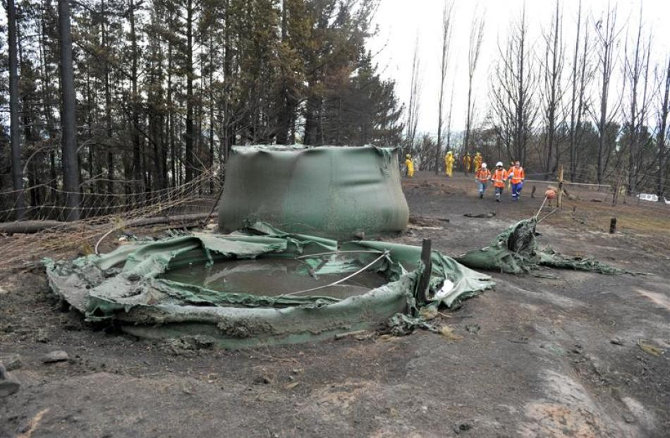Melted water tanks on a Coalstage Rd property.
