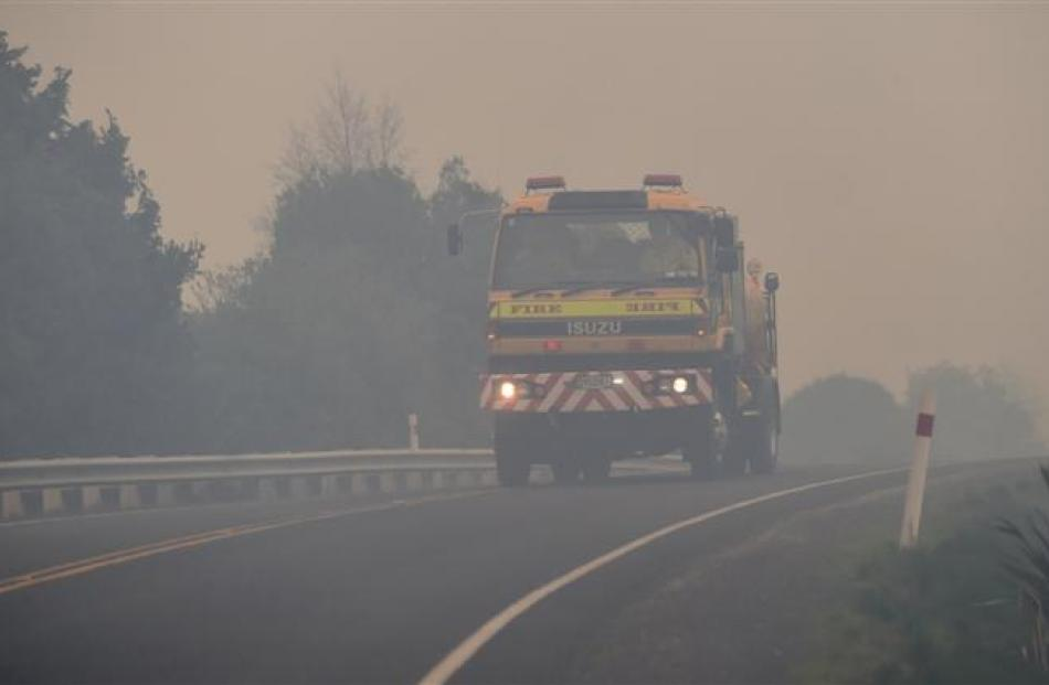 A water tanker travels along Morris Rd to battle the blaze on Wednesday. Photo by Peter McIntosh.