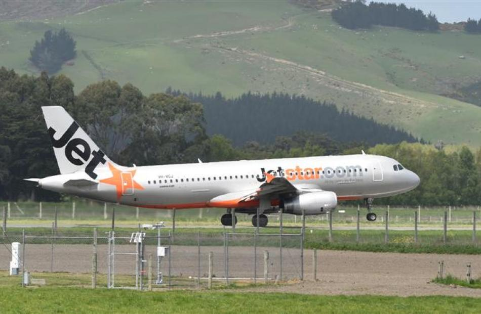A Jetstar Airbus A320 leaves Dunedin Airport for Wellington, a  service the airline has introduced.