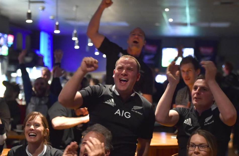 Marty Boyd (left) and Spencer Bremner, of Dunedin, cheer on the All Blacks at The Terrace.