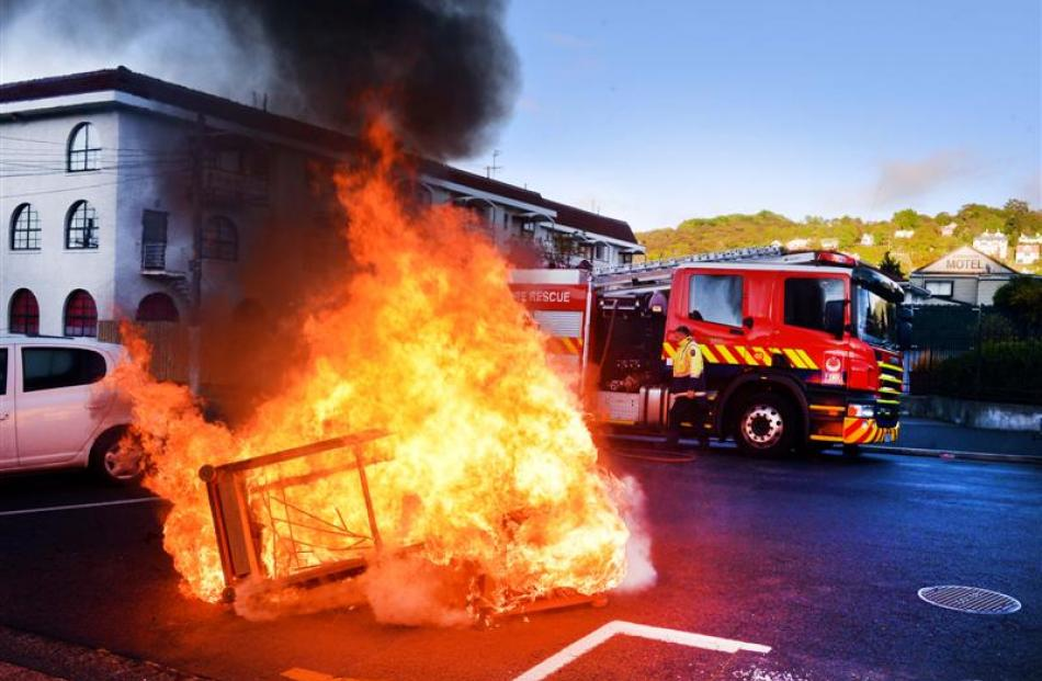 One of several North Dunedin couch fires draws the attention of the Fire Service yesterday...