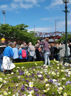 Flower beds took some punishment as people surged to get close to the action. Photo Craig Borley