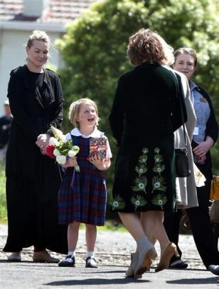 St Mary's School pupil Saffron Chisholm (5), of Mosgiel, gets ready to greet the Royal couple at...