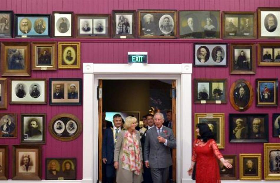 Toitu director Jennifer Evans ushers the prince and  duchess  into the Smith Gallery at Toitu...