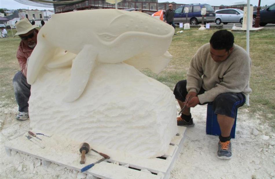 Oamaru artist Silivenusi Funaki (left) gets a little help from his friend Telesi Lea as he...