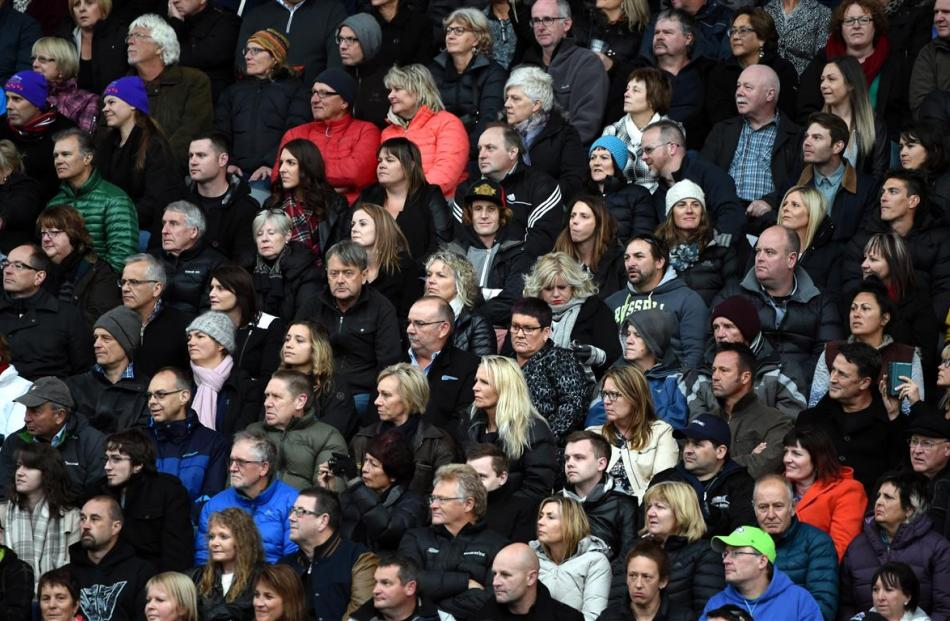 Some of the estimated 35,000 concert goers enjoy the view from the south stand. PHOTO: GREGOR...