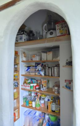 The former confessional has been converted to a pantry.