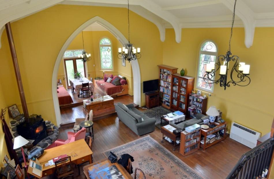 The owners enjoy the sense of space provided by the high ceilings. This view is from the...