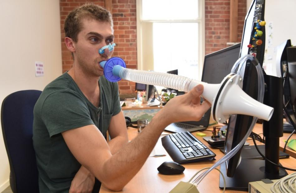 Instructional designer Liam Farley tests a spirometer, measuring his airflow, at ADInstruments'...