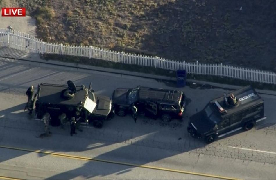 Police armoured cars close in on a suspect vehicle following the incident.