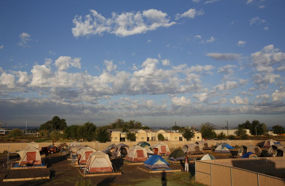 Clouds pass above Camp Hope in Las Cruces, New Mexico.