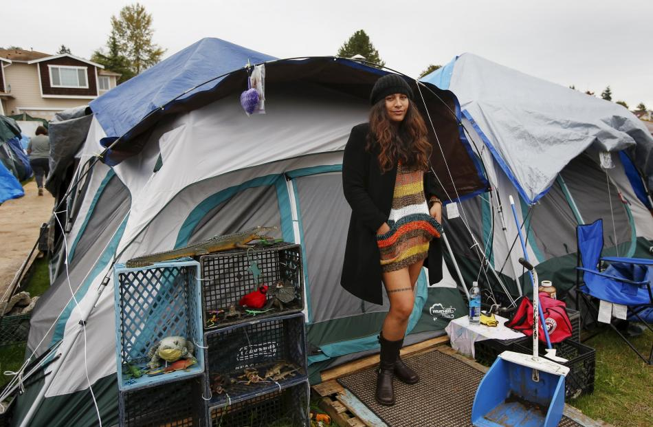 Kalaniopua Young, 32, originally from Hawaii, poses outside her tent at SHARE/WHEEL Tent City 3...