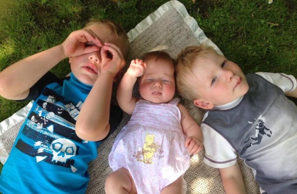 Cooling off in the shade are (l-r) Conan Tabb (5), Dakota Tabb (14 weeks), Riker Tabb (3). Photo...