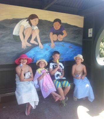 Enjoying ice creams after the beach in Brighton are (l-r) Georgina Te Kanawa, Indi Te Kanawa,...