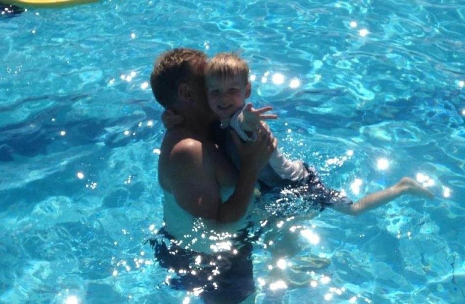 Riker Tabb cools down with his dad, Mike Tabb, at the St Clair Hot Water Pool. Photo Delaine Tabb