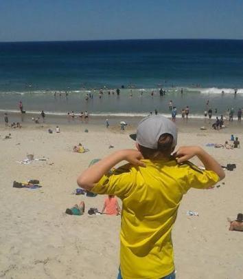 Wendy Elliott's son Cameron gets ready to hit the water at St Clair beach. Photo Wendy Elliott