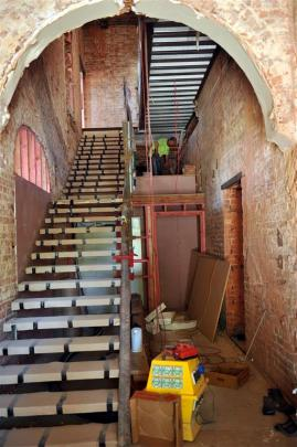 The stairway and atrium in the apartments' entranceway, with the building's brickwork still to be...