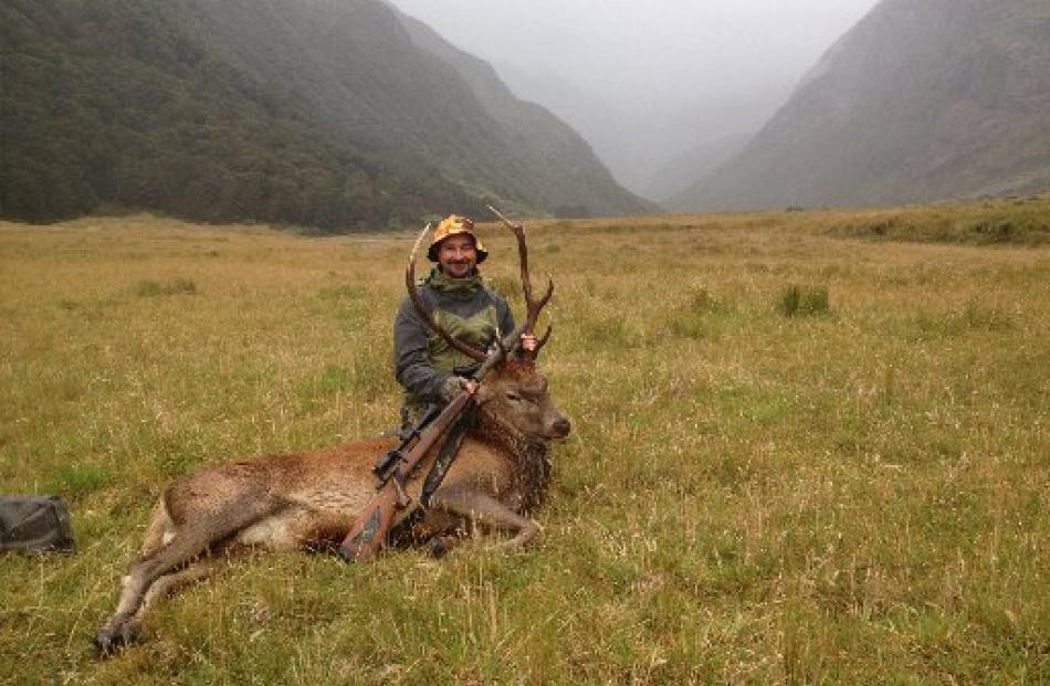 David Rider, of Queenstown, with a red stag in the Greenstone Valley. Photo supplied.