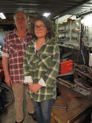 Forged and Crafted's Bill and Michelle Clarke produce their work in their workshop garage in...