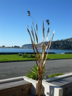 One of Forged and Crafted's popular raupo sculptures at a home in St Clair, Dunedin.