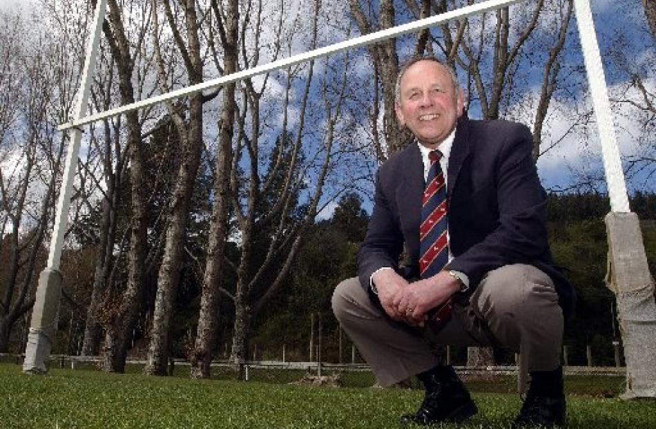 Des Smith celebrates 100 games as manager of the Otago rugby team in 2004. Photo from ODT files.