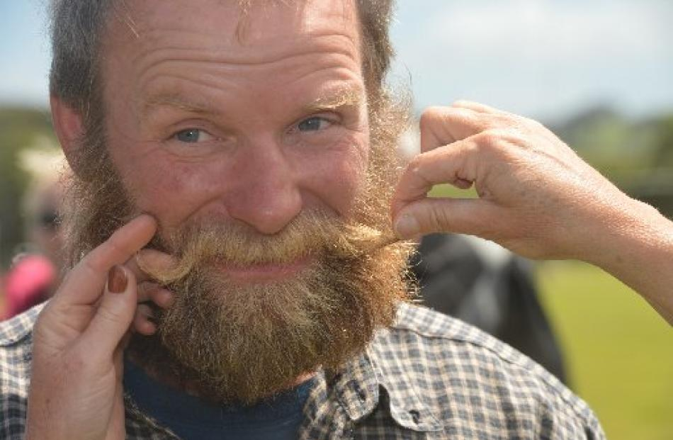 <b>Karl Burgess</b>, from Owaka, allows two women to shape his moustache with boot ... - karl_burgess_from_owaka_allows_two_women_to_shape__56922fdfe4
