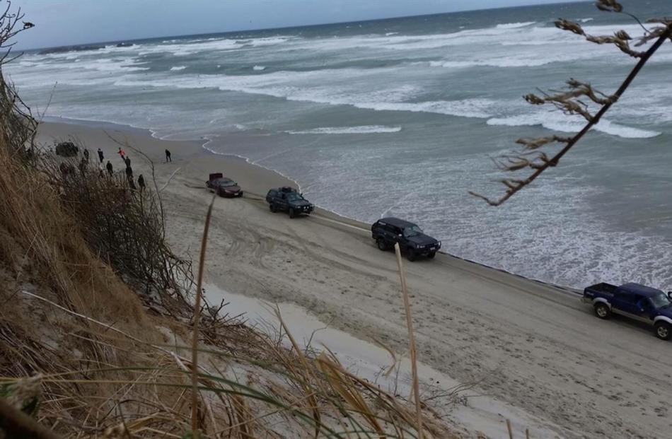 A car is towed from the beach on Sunday.