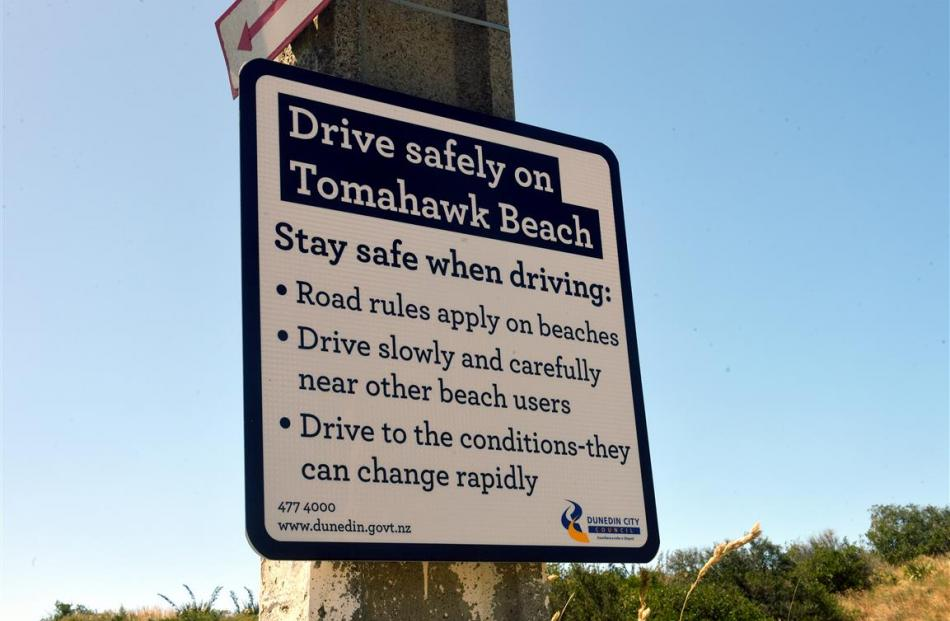 A sign detailing driving requirements for the beach.
