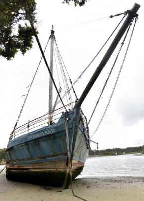 The Portland, beached on the side of the Owaka River.