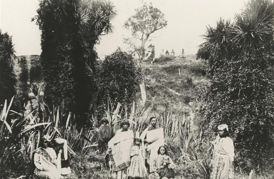 An 1878 photo from the Hocken Collection titled Te Heke (The Migration) to Omarama shows the...