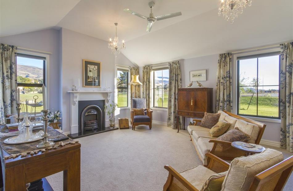 The sitting room has a vaulted ceiling and French doors connecting to a courtyard.