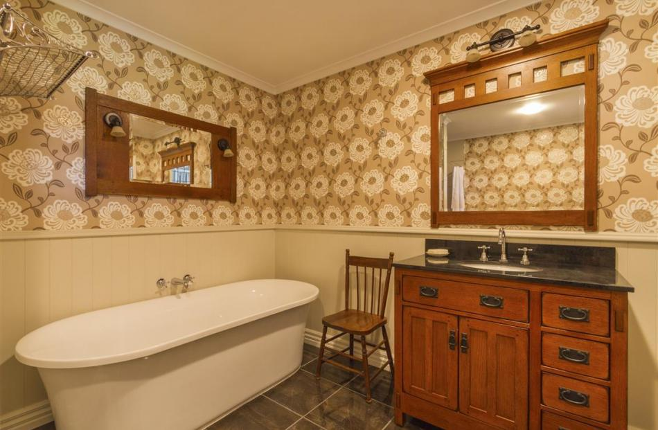 The two bathrooms are in keeping with the home's traditional design.