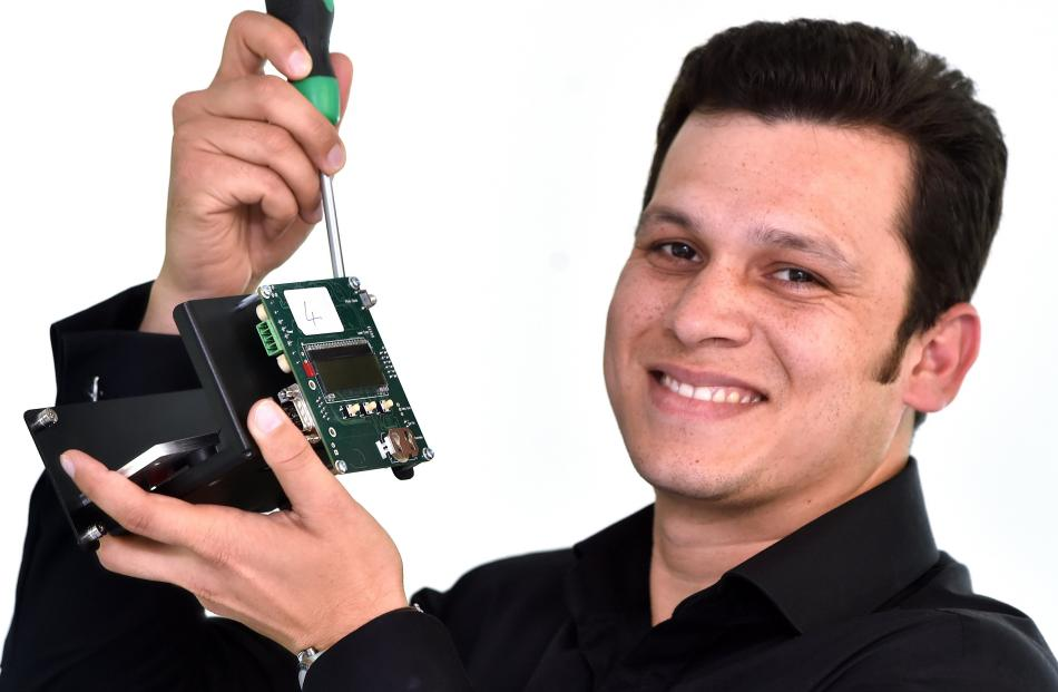 Photonic Innovation chief executive Dr Ojas Mahapatra holds components of an ammonia laser gas...