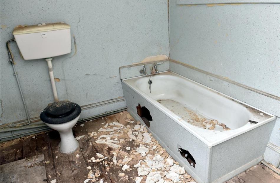 A bathroom shows the effect of more than 30 years of vacancy.