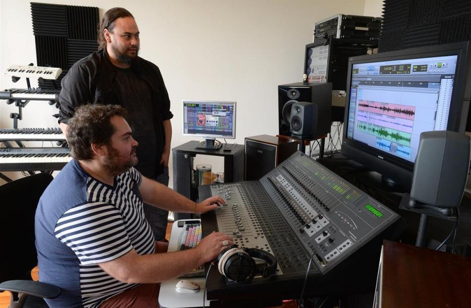 Paul Sammes (seated) works on a song with Dunedin musician Jacob Ambrose, aka Ronnie Stash. Photo...