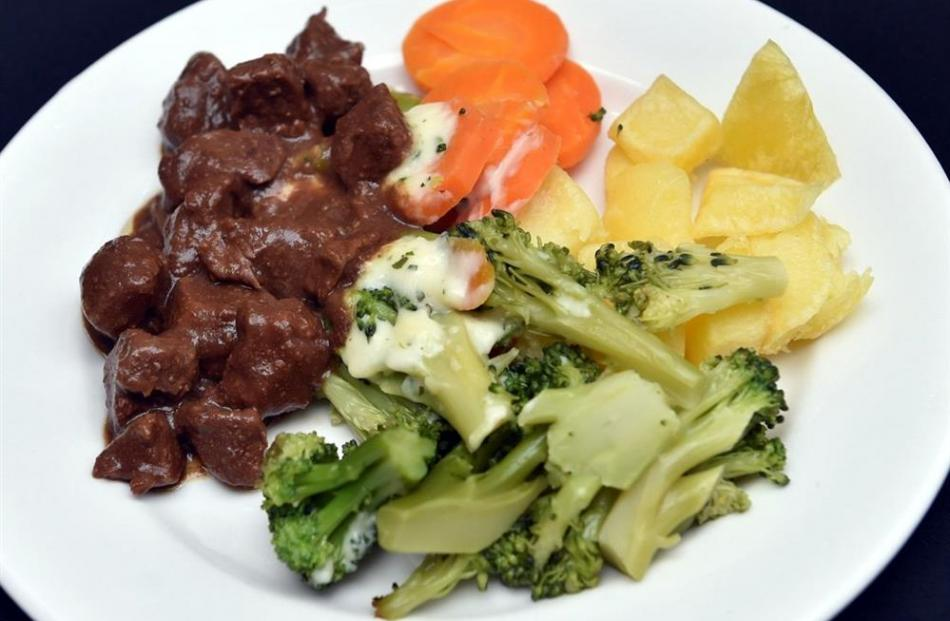 Barbecue beef with potatoes, carrots, broccoli and parsley sauce.