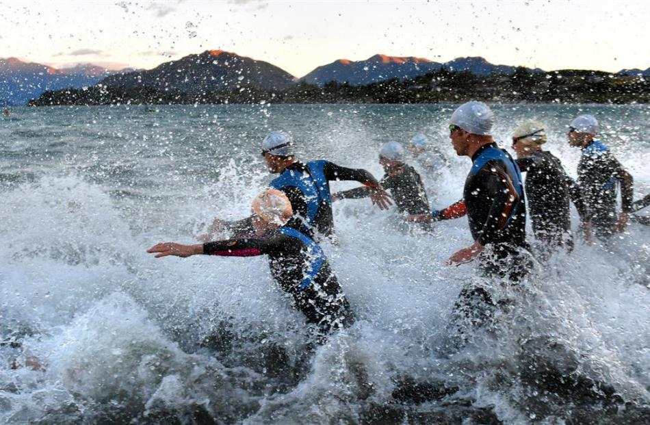 The competitors take to the water at the start of Challenge Wanaka on Saturday morning. Photos by...