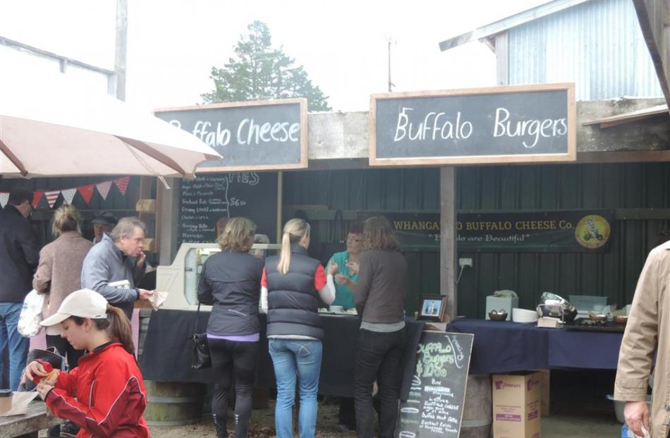 Buffalo cheese and burgers for sale at Matakana market.