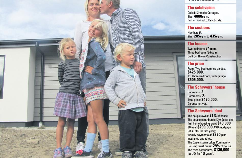 A family ready and waiting to move into their Kirimoko cottage in Wanaka (front, from left) Paige...