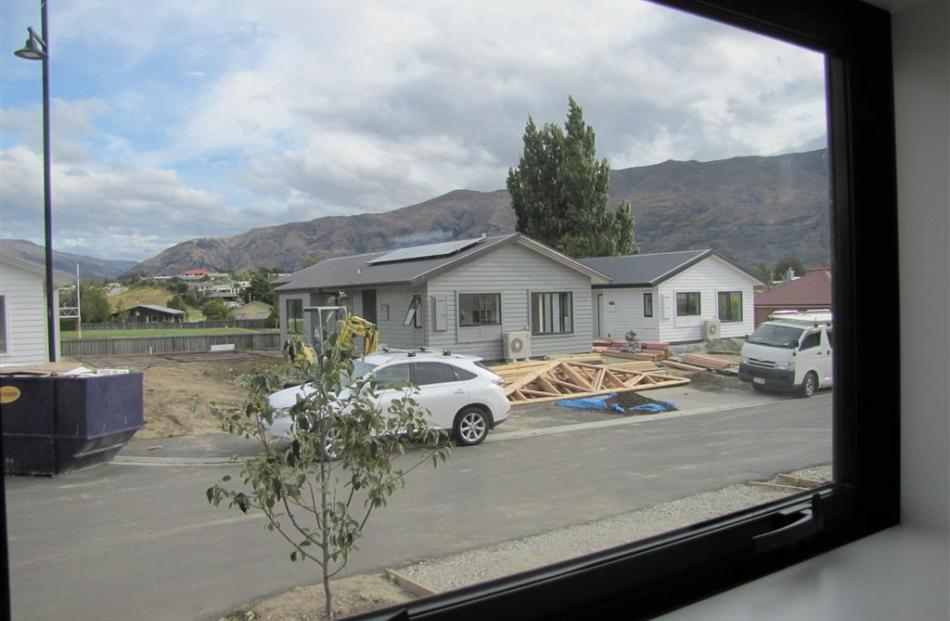 """The view from the Schryvers' house of the nine-house subdivision of """"affordable"""" homes built in..."""