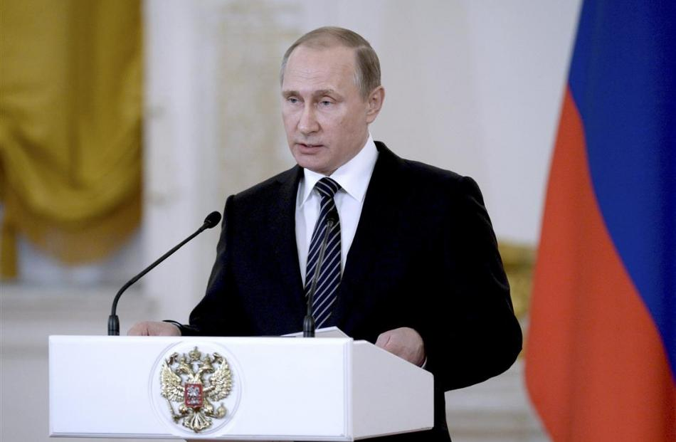 Russian President Vladimir Putin delivers a speech during an awards ceremony for soldiers...