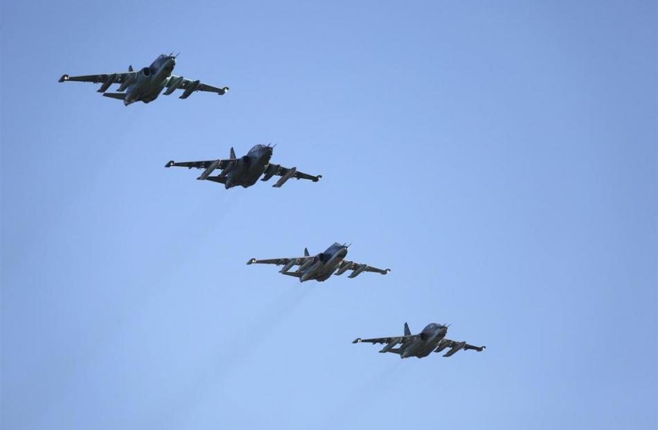 Russian Sukhoi Su-25 fighter jets fly in formation after returning from Syria, before landing at...