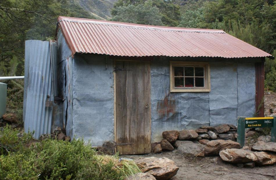 The renovated hut, with new door, new windows and water tank.