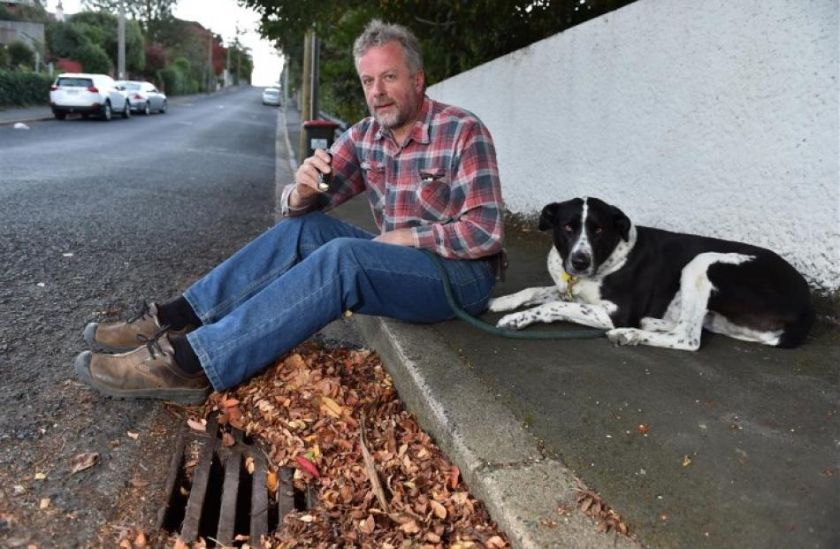 Lee Vandervis beside a stormwater drain with his dog Lola. He says concerns he raised about poor...