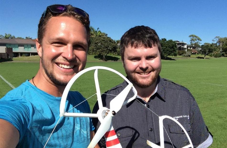 Scott Cardwell (left) and web developer Josh Lowry try out a drone lent by a client in Auckland....