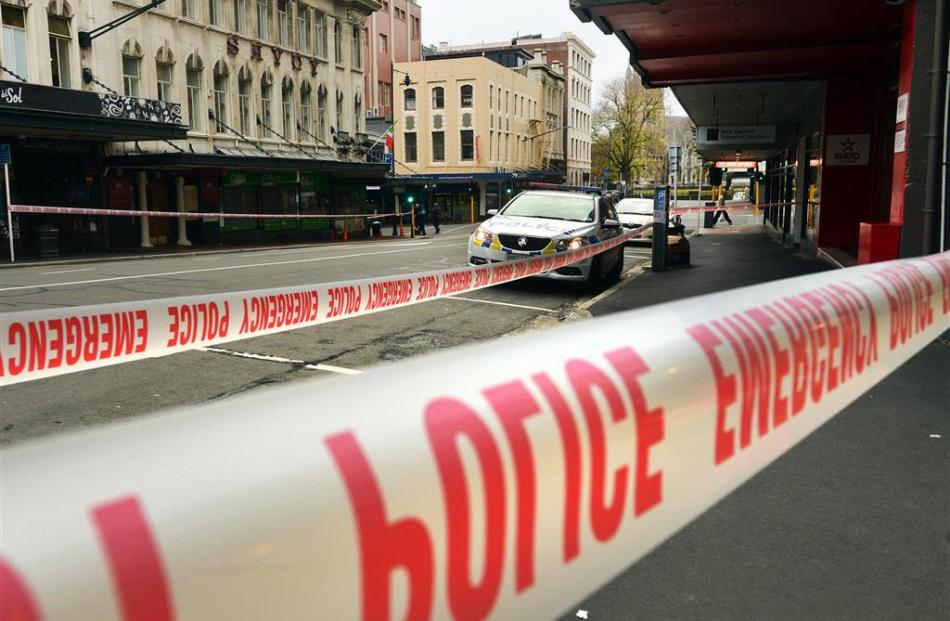 Police investigate a stabbing in central Dunedin yesterday. Photo: Stephen Jaquiery