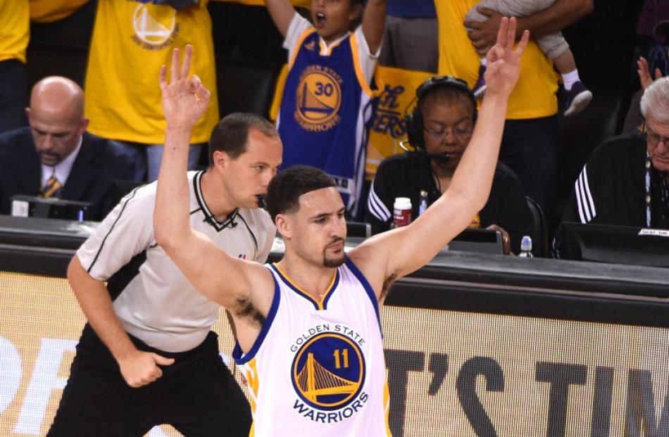 54e7eb10c18 Golden State guard Klay Thompson celebrates after hitting a three-point  shot during the Warriors
