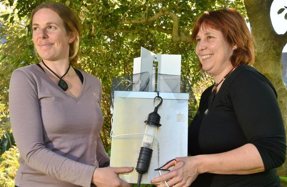 Landcare Research scientist Barbara Anderson and Department of Conservation ranger Sarah Forder...